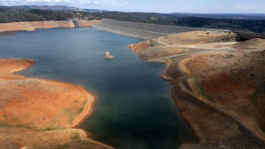 Dry hillsides surround Lake Oroville on Saturday, May 22, 2021, in Oroville, Calif. At the time of this photo, the reservoir was at 39 percent of capacity and 46 percent of its historical average.(AP Photo/Noah Berger)