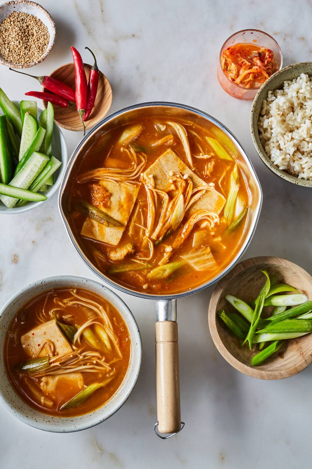 """Kimchi Jjigae (Vegan Korean Soft Tofu and Kimchi Stew), from Dr. Linda Shiue's cookbook """"Spicebox Kitchen,"""" is traditionally cooked in a stone pot, but any heavy pot will work well. (Michelle K. Min/Go Hachette)"""