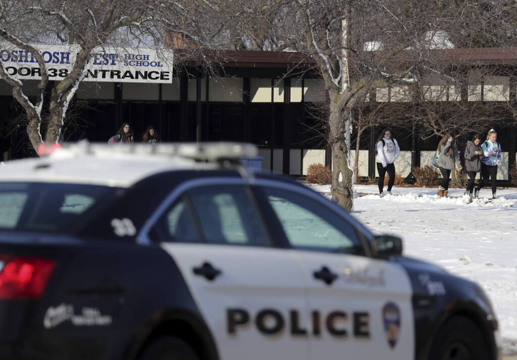 Students are evacuated from the scene of an officer involved shooting at Oshkosh West High School after an armed student confronted a school resource officer on Tuesday December 3, 2019, at in Oshkosh, Wis. Police in Oshkosh say a police officer and an armed student whom he confronted at the school were both wounded in the confrontation Tuesday morning. (Wm. Glasheen/The Post-Crescent via AP)