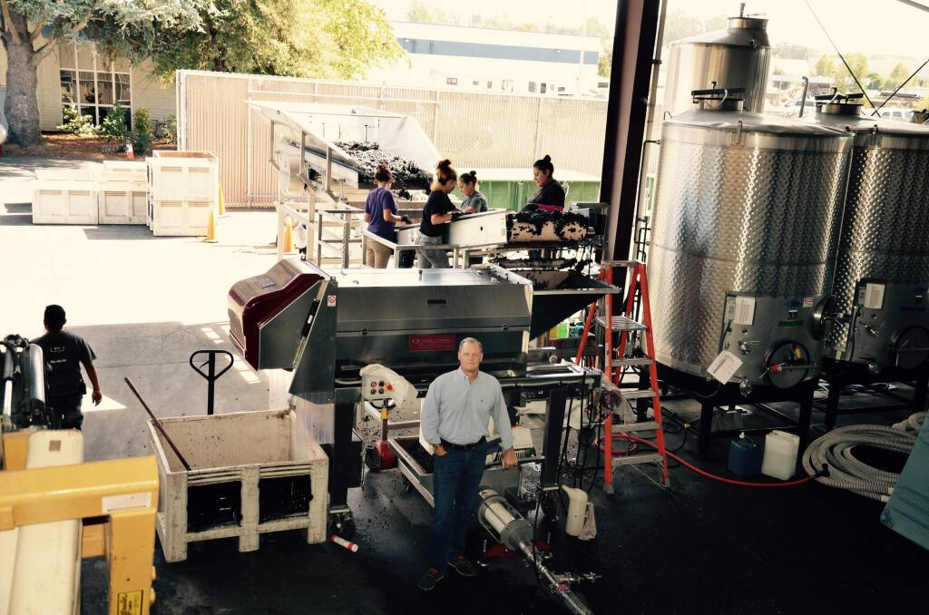 Bin to Bottle plans a big expansion of its Napa custom-winemaking facilities in 2017. Managing partner John Wilkinson is standing in front of grape-sorting and grape crush equipment. (BINTOBOTTLE.COM)