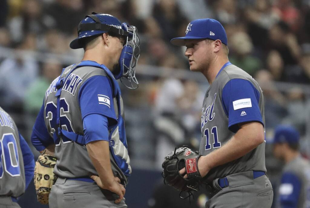 Israel pitcher Gabe Cramer, right, talks with catcher Ryan Lavarnway against South Korea during a first-round game of the World Baseball Classic at Gocheok Sky Dome in Seoul, South Korea, Monday, March 6, 2017. (AP Photo/Lee Jin-man)