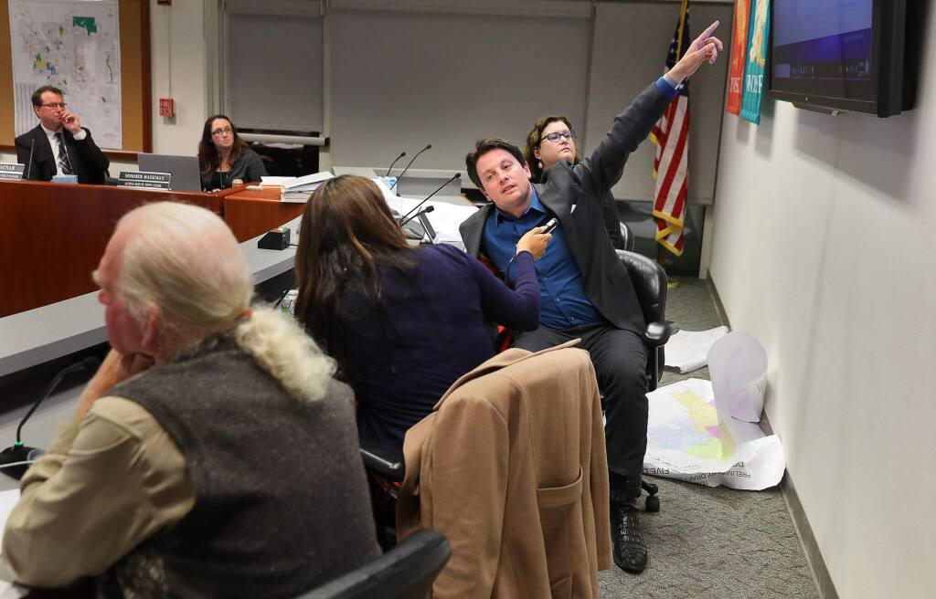 Windsor mayor Dominic Foppoli, center, vice mayor Deborah Fudge, right, and councilmembers Esther Lemus and Sam Salmon work on creating new district lines during a town council meeting in Windsor on Monday, February 25, 2019. (Christopher Chung/ The Press Democrat)