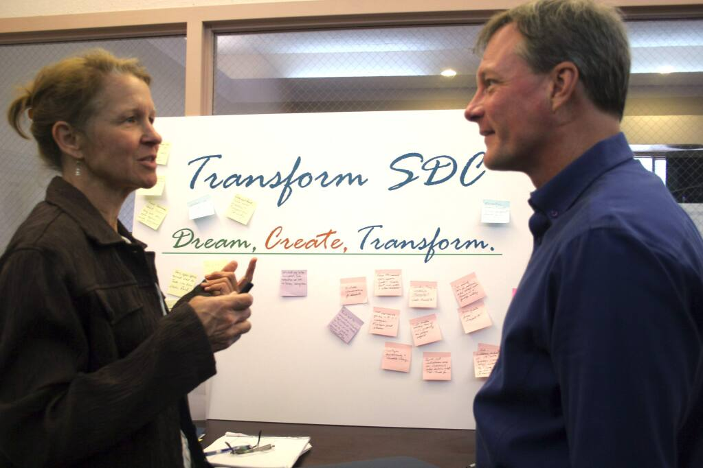 Christian Kallen/Index-TribuneJeanne Wirka of Audubon Canyon Ranch discusses the Sonoma Developmental Center with the Sonoma Land Trust's John McCaull, at the SDC Community Workshops, May 2, at Vintage House senior center.