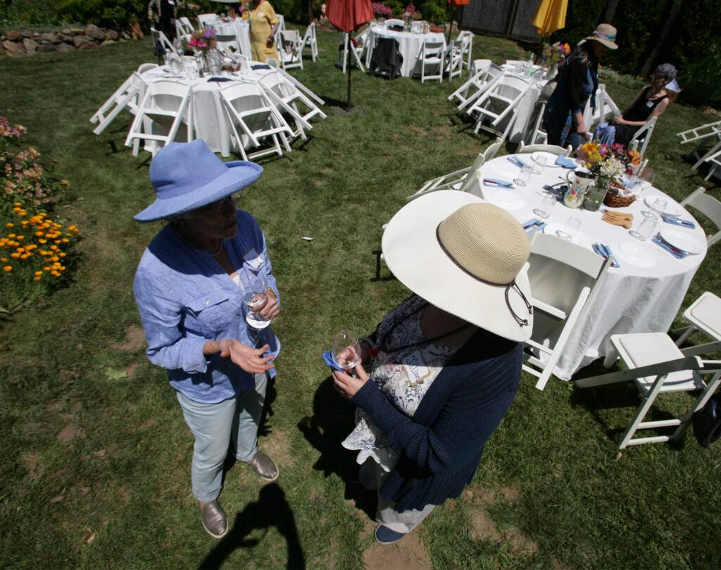 Nancy Hair and Jillian Standish talk at a fundraiser for Sister District, an organization created to flip Red states to Blue. The event is held at Casa Flores on Sunday, June 16, 2019 in Sebastopol, Ca. (Frankie Frost/Special to The Press Democrat)
