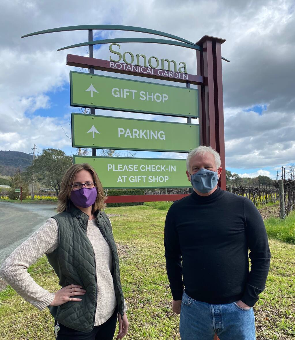 Kate Rabuck, curator of education and exhibitions, and Scot Medbury, director, show the Sonoma Botanical Garden's new sign. (Sonoma Botanical Garden)