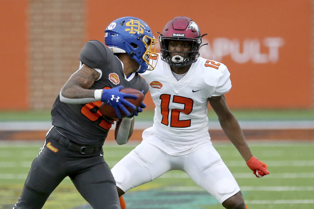 Wide receiver Cade Johnson of South Dakota State, left, runs the ball as defensive back Bryan Mills of North Carolina Central defends during the second half of the Senior Bowl in Mobile, Alabama, on Saturday, Jan. 30, 2021. (Rusty Costanza / ASSOCIATED PRESS)