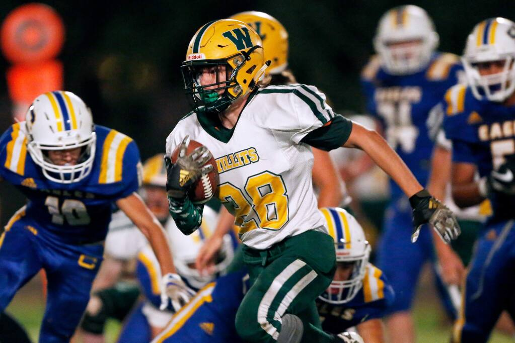 Willits' Gabe McGinnis gets past Cloverdale's defense during the first half in Cloverdale on Friday, Sept. 27, 2019. (Alvin Jornada / The Press Democrat)