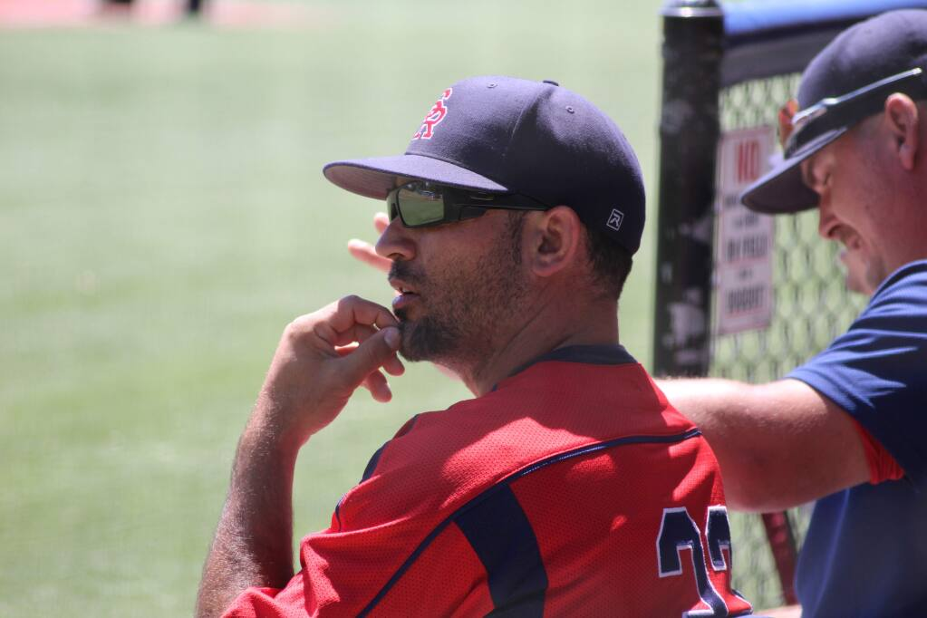 SRJC baseball coach Ben Buecnher watches as his team finishes off Modesto College in a two-game sweep in the first round of the NorCal regional playoffs. (Albert Gregory / for The Press Democrat)
