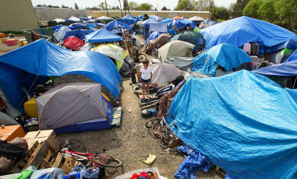 The sprawling homeless encampment behind the Dollar Tree store in Roseland where homeless advocates have sued to block the clean out of the camp. (Photo by John Burgess/The Press Democrat)
