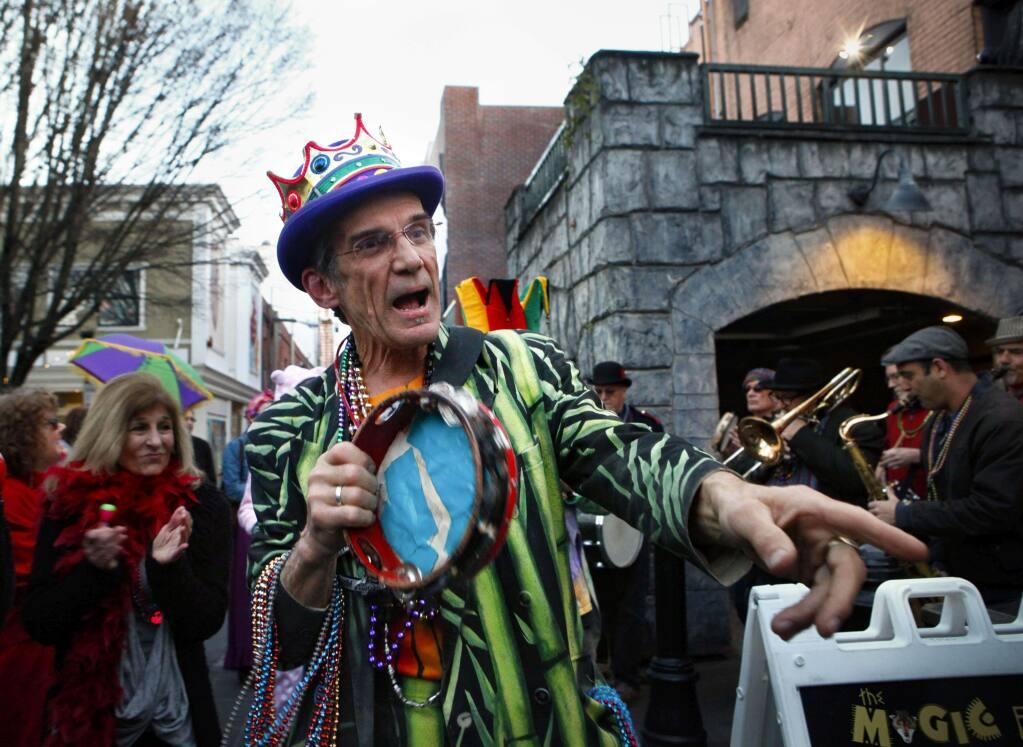Tim Eschliman leading the Mardi Gras parade through downtown Petaluma in 2017.(CRISSY PASCUAL/ARGUS-COURIER STAFF)