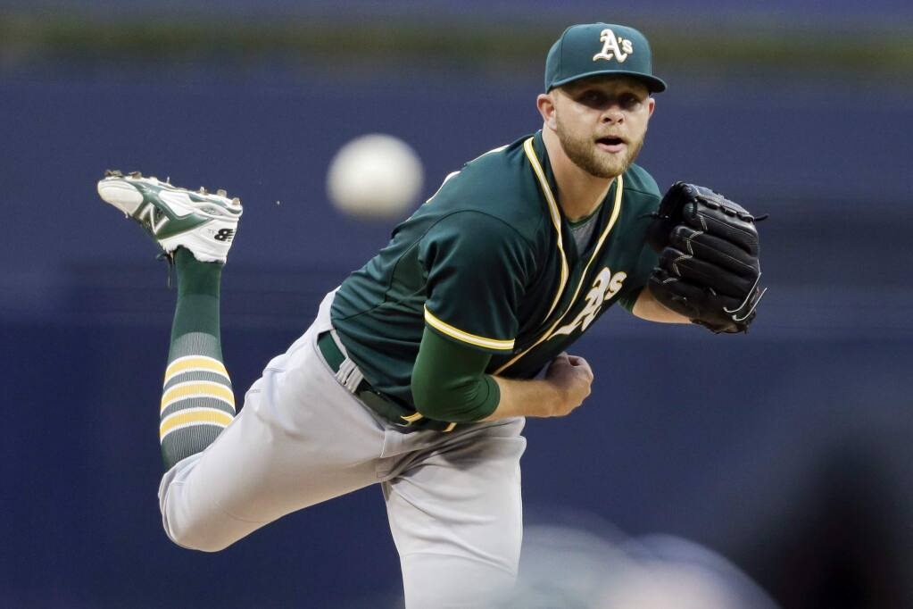 Oakland Athletics starting pitcher Jesse Hahn works against a San Diego Padres batter during the first inning of a baseball game Monday, June 15, 2015, in San Diego. (AP Photo/Gregory Bull)