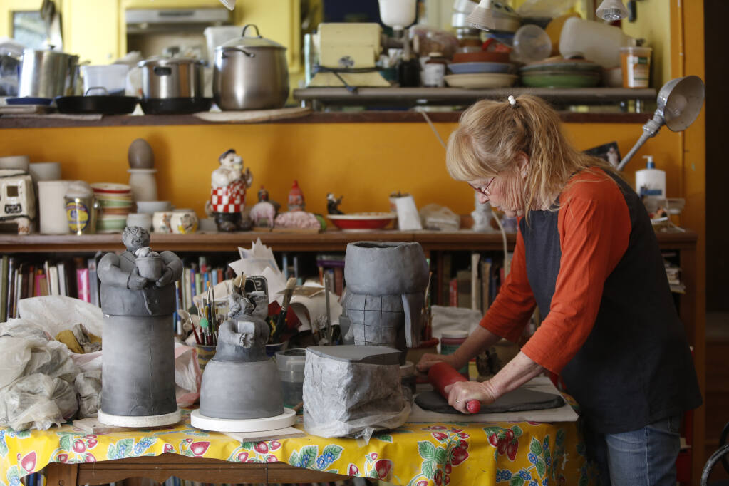 Artist and potter Cynthia Hipkiss works on a chef-themed cookie jar at her studio in Sonoma on Thursday, June 17, 2021. (Beth Schlanker/The Press Democrat)