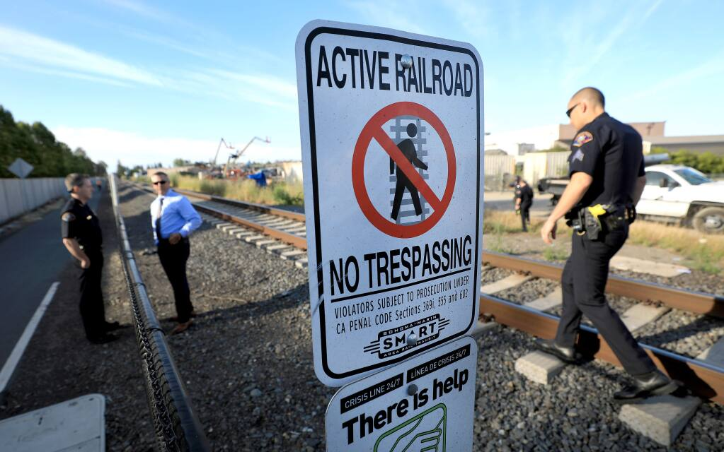 Rohnert Park public safety officers document the scene of SMART train vs bicyclist fatality at Golf Course Drive in Rohnert Park on Friday. It was the second train fatality in as many days at the same location. (KENT PORTER / The Press Democrat, 2018)