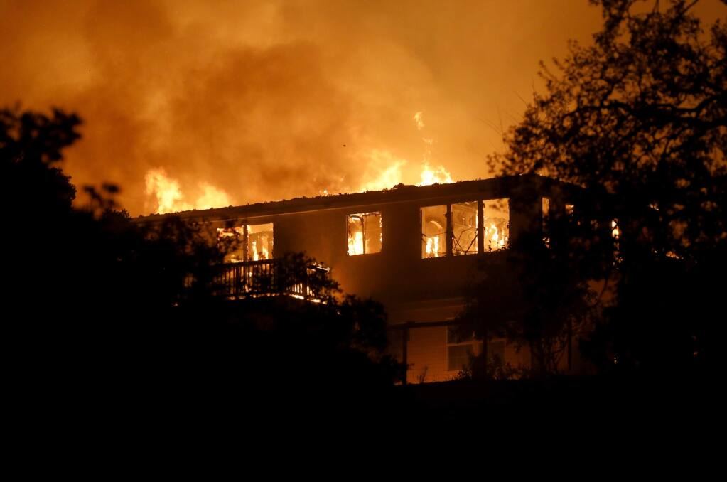 A home burns in the Fountaingrove area on Monday, October 9, 2017 in Santa Rosa, California . (BETH SCHLANKER/The Press Democrat)