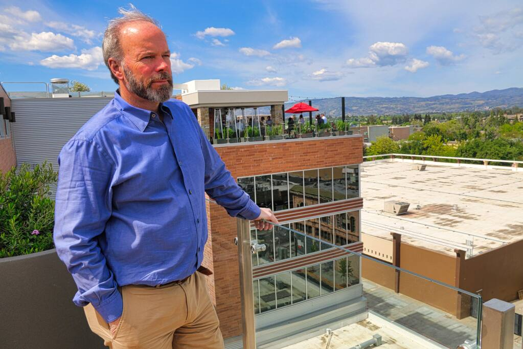 Todd Zapolski, head of the First Street Napa mixed-use development in downtown Napa, shows the view to the north in Napa Valley from the roof of the Archer hotel. Also visible is the rooftop lounge and the Kohl's department store, a property Zapolski Real Estate also controls. (JEFF QUACKENBUSH / NORTH BAY BUSINESS JOURNAL) May 1, 2018