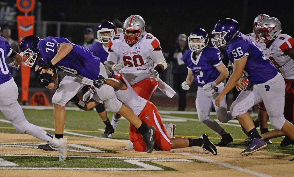 SUMNER FOWLER/FOR THE ARGUS-COURIERPetaluma's outstanding lineman Luke Haggard (70) had a chance to carry the ball in a game against Montgomery. He gained 12 yards on the play.The senior is normally seen blocking or tackling.