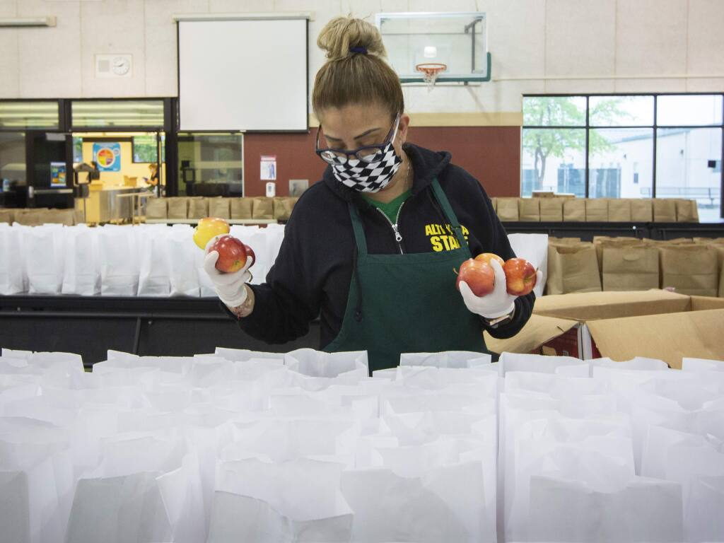 School district employees bagged over 1,000 breakfast and lunch combos in the high school's multipurpose room every weekday.T he lunch bags were available during weekdays at schools around the valley for anyone under 18 years old.