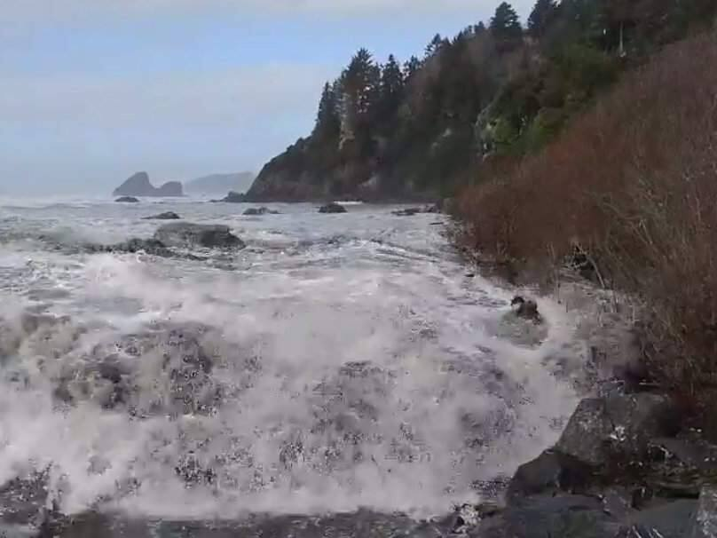 A screenshot from video posted to Facebook showing three people knocked off their feet at Moonstone Beach near Eureka, Saturday, Jan. 11, 2019. (MARCELLA OGATA-DAY/ FACEBOOK)