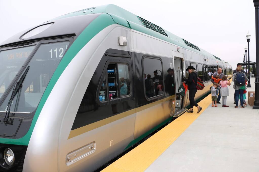 Passengers board a Sonoma-Marin Area Rail Transit train at the Cotati station Saturday, Aug. 6, 2016. (Angela Hart/The Press Democrat)
