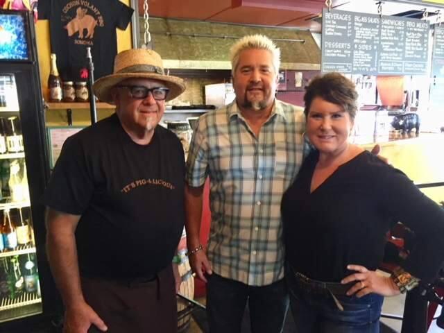 Rob Larman, Guy Fieri and Lizzie Larman at Cochon Volant Smokehouse.