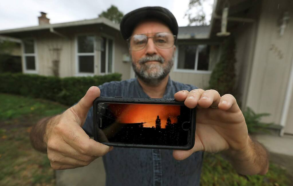 Martin Whiteside was awoken by a neighbor at 1am on Oct. 9, to evacuate his home as the Tubbs fire raced towards Rincon Valley and Santa Rosa. this was the view from his block when he stepped outside that night. There was no notification with his phone or an emergency radio alerting him to the firestorm. (Kent Porter / The Press Democrat) 2017