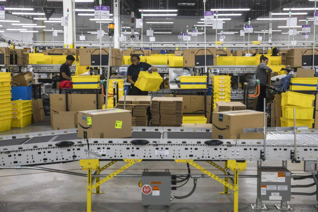 FILE -- Workers at an Amazon fulfillment center in Staten Island, May 15, 2019. Some of Amazon's warehouse employees work as social media ambassadors, responding to critical tweets about the e-commerce giant's punishing working conditions. (Hiroko Masuike/The New York Times)