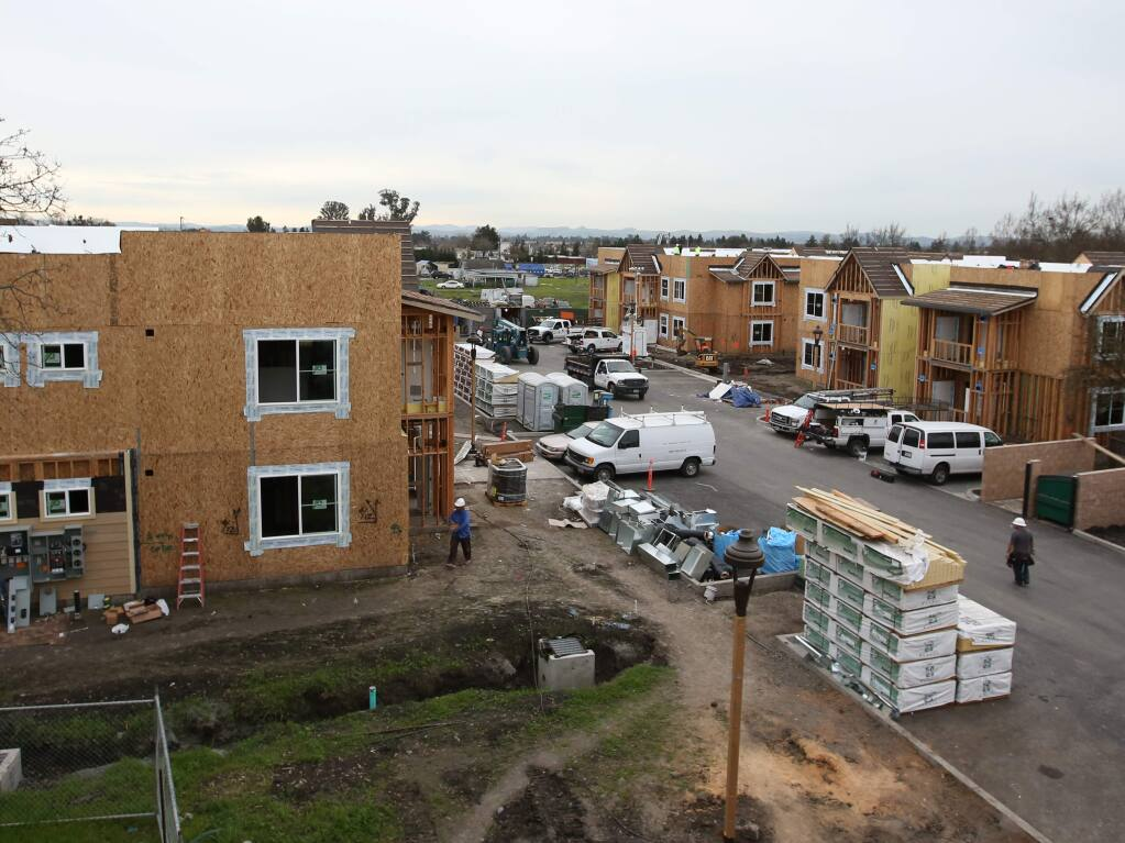 Crews work on an affordable housing project under construction in Santa Rosa in 2015. (PD FILE)
