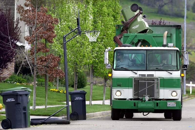 A Ratto Group truck collects garbage in the Elsbree Meadows subdivision in Windsor. (KENT PORTER/ PD)