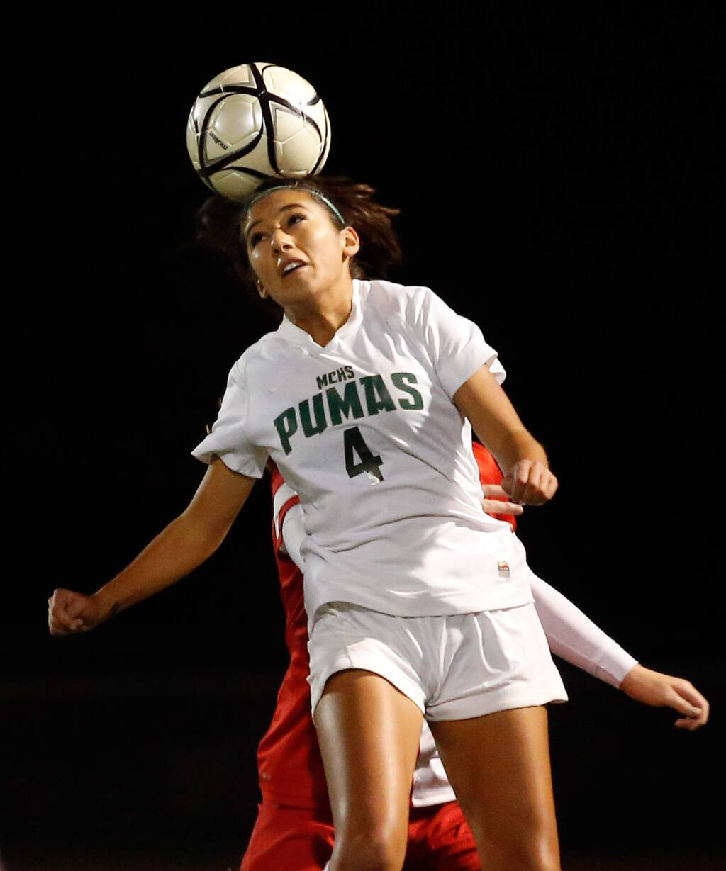 Maria Carrillo's Maddy Gonzalez (4) gets up for a header during the first half of the NCS Division 1 championship girls soccer match between Maria Carrillo and Montgomery high schools in Santa Rosa, California on Saturday, November 14, 2015. (Alvin Jornada / The Press Democrat)