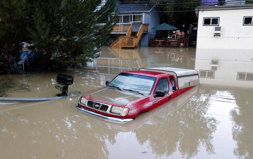 A truck sits submerged in floodwaters in Forestville, Calif., on Thursday, Feb. 28, 2019. (AP Photo/Josh Edelson)