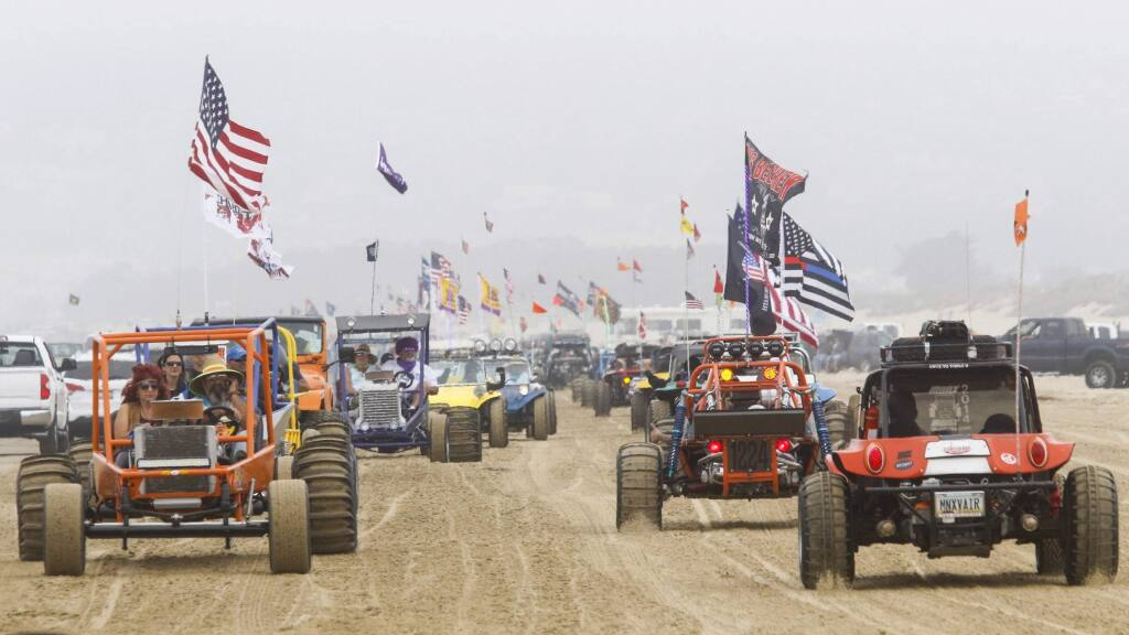 In this Sunday, Aug. 18, 2018, photo hundreds of dune buggies parade along the Oceano Dunes State Recreational Vehicle Area, the line stretching south to north in Oceano, Calif. The California Coastal Commission has decided on Thursday, July 11, 2019, not to make any immediate changes to the rules for off-road vehicle use at Oceano Dunes. Oceano Dunes, which draws roughly 2 million visitors a year, is the only oceanfront state park that allows vehicles on its sand. (David Middlecamp/The Tribune (of San Luis Obispo) via AP)