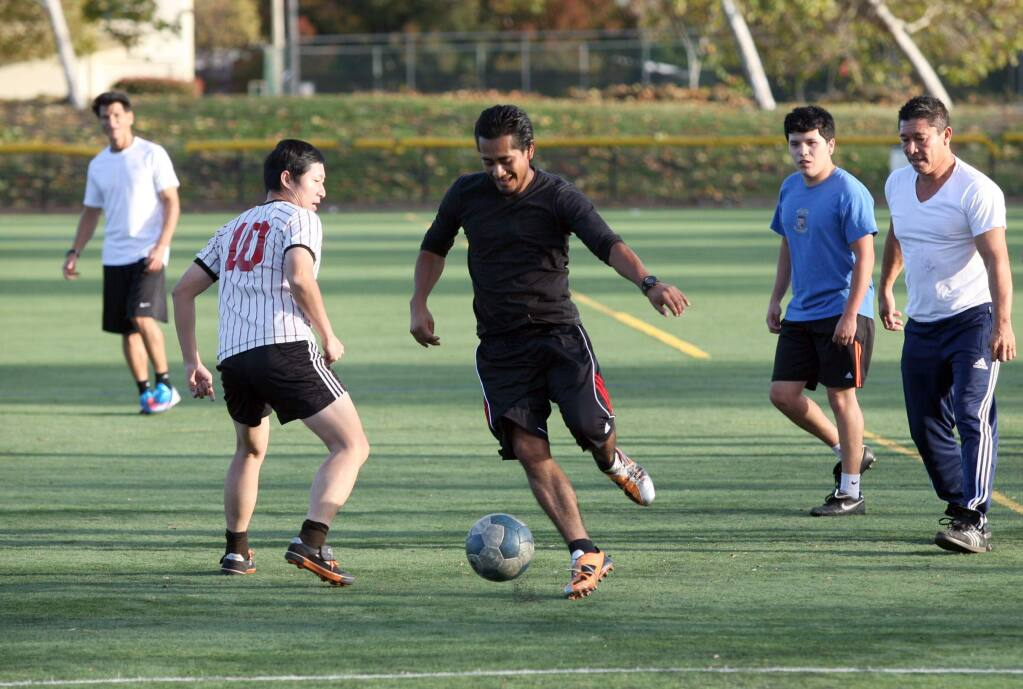 A friendly soccer game being played on the turf field at Lucchesi Park in Petaluma on Monday, November 17, 2014. (SCOTT MANCHESTER/ARGUS-COURIER STAFF)