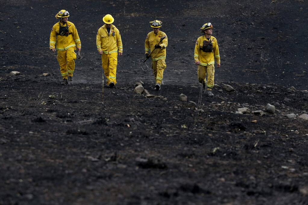 Fire fighters from Cal Fire do inspections of residences on Monday, Sept. 14, 2015 in Middletown. (BETH SCHLANKER/ The Press Democrat)