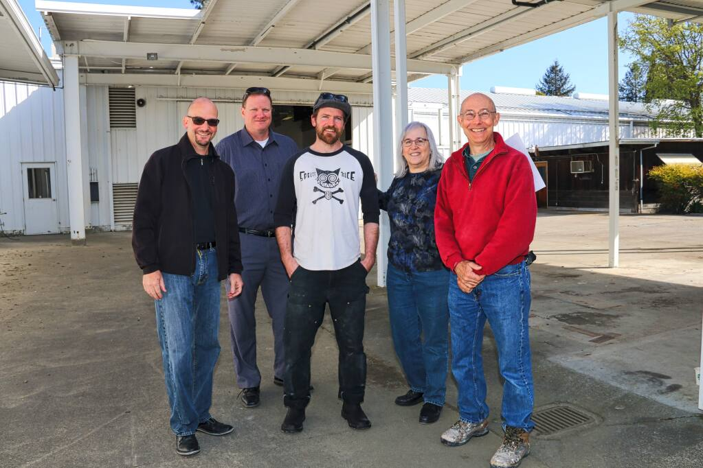 Part of the team behind 180 Studios - Dan Blake and Matt O'Donnell of Sonoma County Office of Education, General Manager David Farish, project administrator Sandy Litzie and Keysight Technologies retiree Tom Fetter - at the southwest Santa Rosa buildings set to house the maker facility in April 2016. (Jeff Quackenbush/North Bay Business Journal, March 30, 2016)
