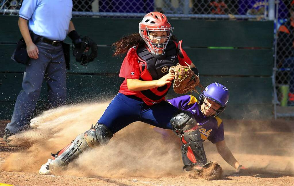 Rancho Cotate's Carolina Camacho forces out Ukiah's Anna Brazil at home plate with the bases loaded in the 1st inning. (JOHN BURGESS / Sonoma Magazine)