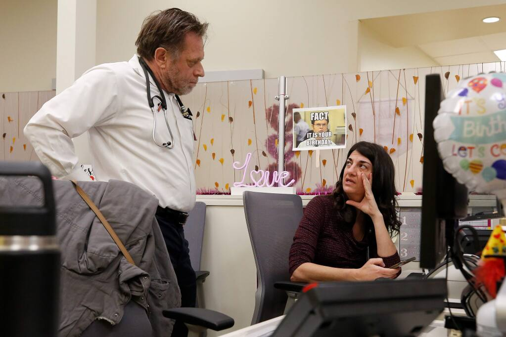 Dr. Benjamin Mills, left, talks with family nurse practitioner Kalanete Baruch in the office area at Santa Rosa Community Health's Dutton Campus in Santa Rosa, California, on Thursday, January 17, 2019. (Alvin Jornada / The Press Democrat)