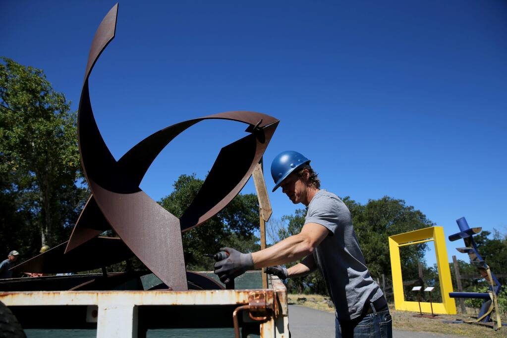 Petaluma sculptor Sean Paul Lorentz prepares his sculpture titled 'Blue' to be unloaded and installed at Paradise Ridge Winery. Photo taken in Santa Rosa, Calif., on Tuesday, June 16, 2020. (BETH SCHLANKER/ The Press Democrat)