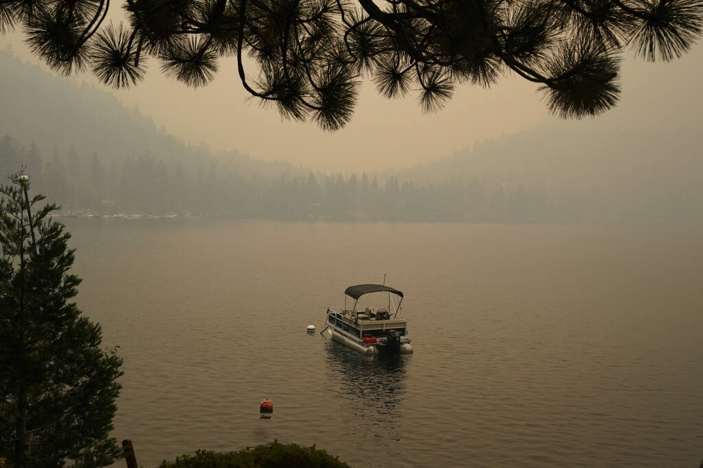 Smoke from the Caldor fire shrouds Fallen Leaf Lake near South Lake Tahoe, Tuesday, Aug. 24, 2021.  (AP Photo/Rich Pedroncelli)