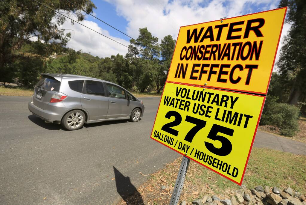 A sign at the private Palomino Lakes subdivision east of Cloverdale, which has its own water system, outlines conservation efforts. (KENT PORTER/ PD)