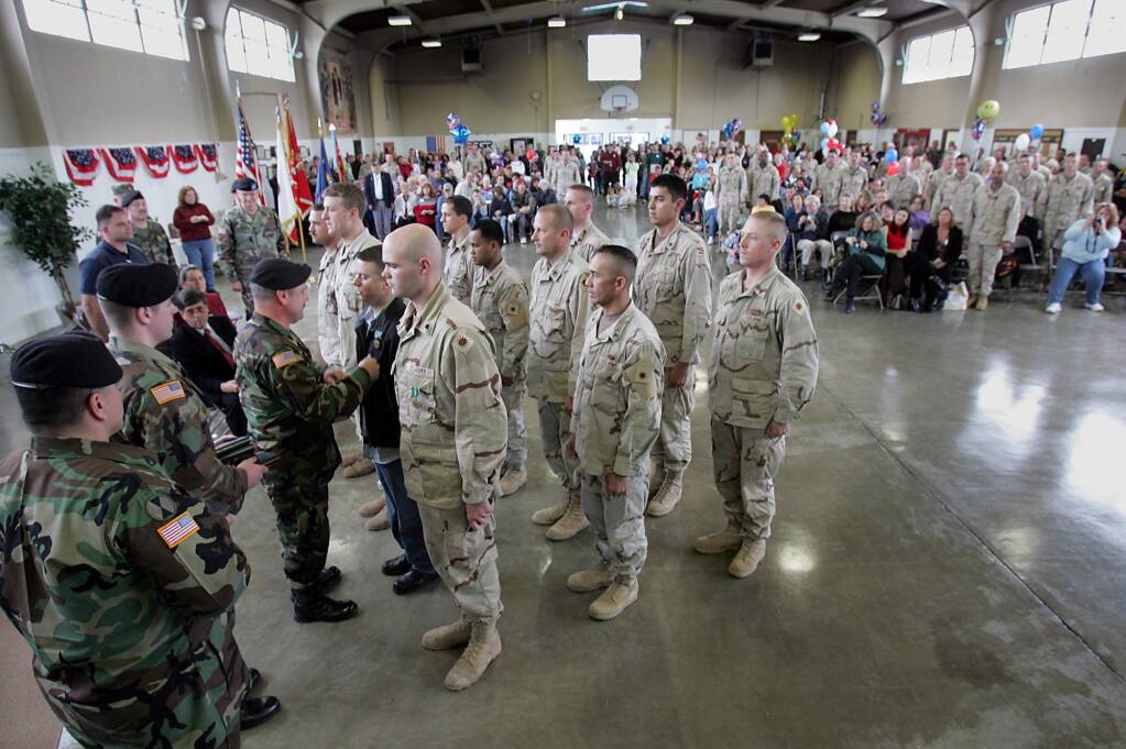 Members of the National Guard 579th Engineer Battalion receive the U.S. Army commendation medal for their service in Iraq at the Petaluma armory in 2005. (PD File)