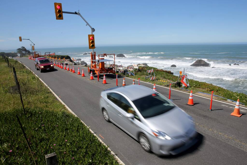 Cars drive on Highway 1, after the southbound lane was closed at Gleason Beach north of Bodega Bay, California on Wednesday, May 22, 2019. (BETH SCHLANKER/The Press Democrat)