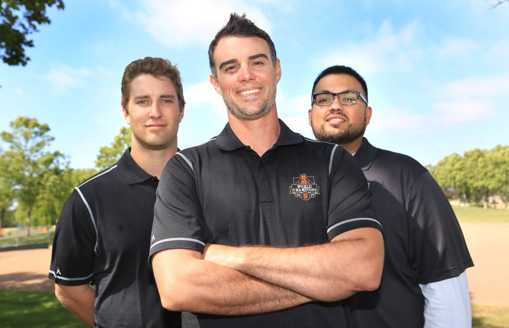 Former Giants pitcher Noah Lowry, center, teamed up with Junior Giants ambassador Elliott North, left, and recreation and parks specialist Juan Flores, right, to start a branch of the program in Santa Rosa in 2015. (KENT PORTER / PD)