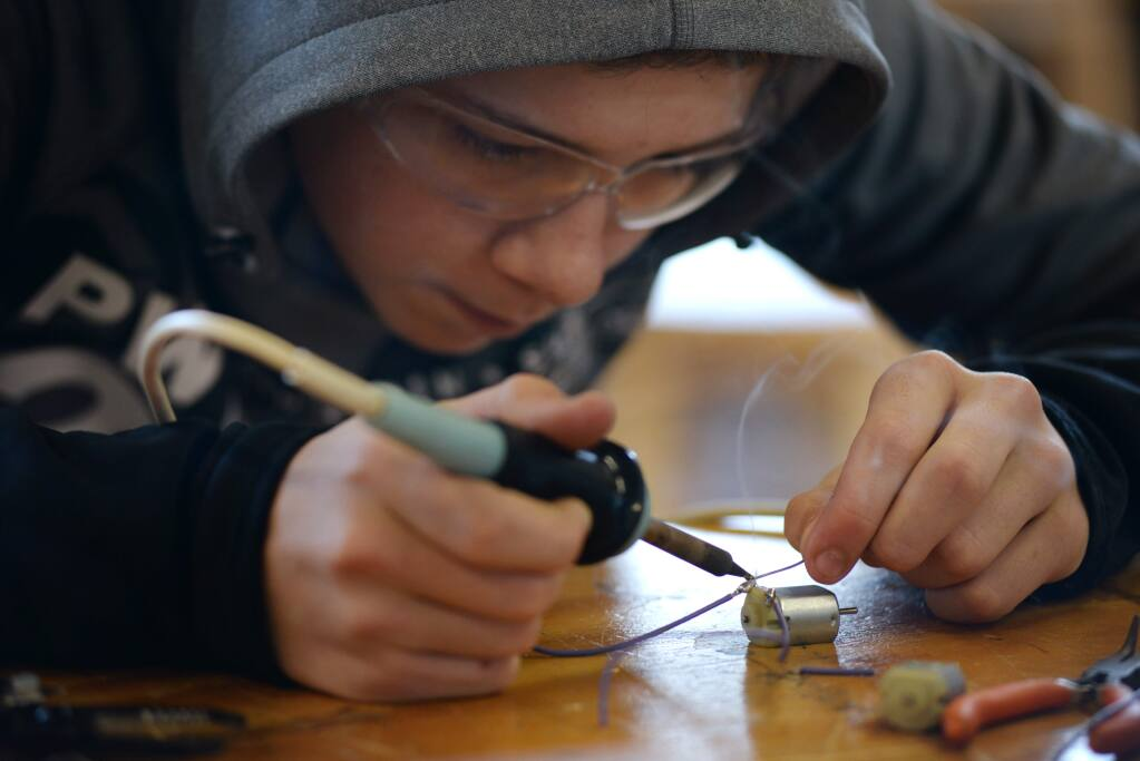 Analy High freshman Iain Douch, 15, soldering some stereo parts during a class at Analy High in Sebastopol where students participate in the hands-on education program known as Project Make. February 5, 2016. (Photo: Erik Castro/for The Press Democrat)