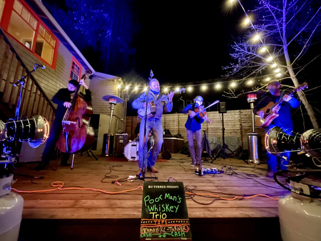 """Poor Man's Whiskey performs at a recent """"In Your Driveway (or Backyard) Concert Series"""" show in Sebastopol. (KC Turner)"""