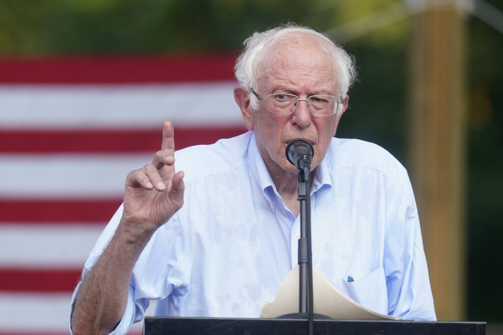 """Sen. Bernie Sanders, I-Vt., speaks during town hall at Tippecanoe County Amphitheater, Friday, Aug. 27, 2021, in West Lafayette, Ind. """"My Republican colleagues are telling everybody that Bernie Sanders and the Democrats are going to raise taxes. You're right, we're gonna raise them on the richest people in this country,"""" Sanders said to the cheers of about 1,500 who braved sweltering heat and humidity at the outdoor amphitheater. (AP Photo/Darron Cummings)"""