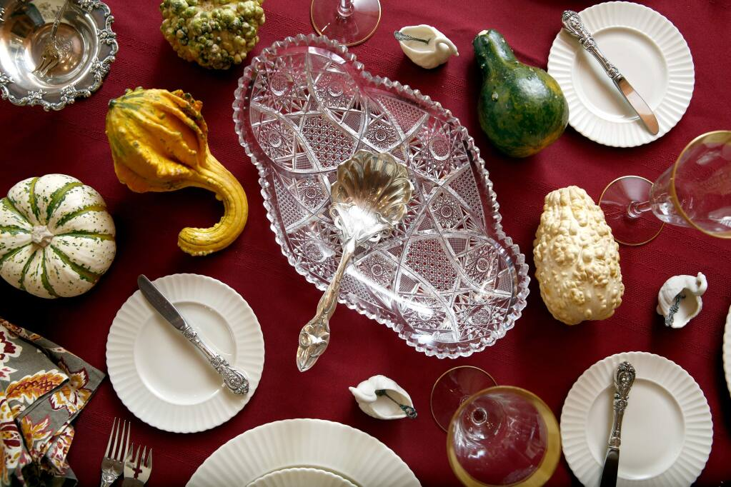 Allie Andrews decorates her holiday table with china, silver and glass belonging to herself, her mother and her grandmother. Photo taken at her home in Petaluma, on Tuesday, November 10, 2015. (BETH SCHLANKER/ The Press Democrat)