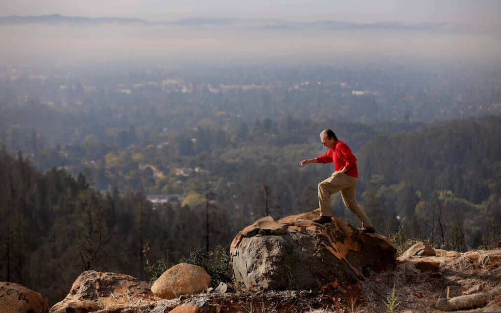 The view from Jim Finn's lot in Fountaingrove is stunning, but the Tubbs fire razed his home and left heat cracked boulders and fried trees, Wednesday, October 16, 2019 in Santa Rosa. Just recently, Finn settled with his insurance company but is unsure he will be rebuild. (Kent Porter / The Press Democrat)