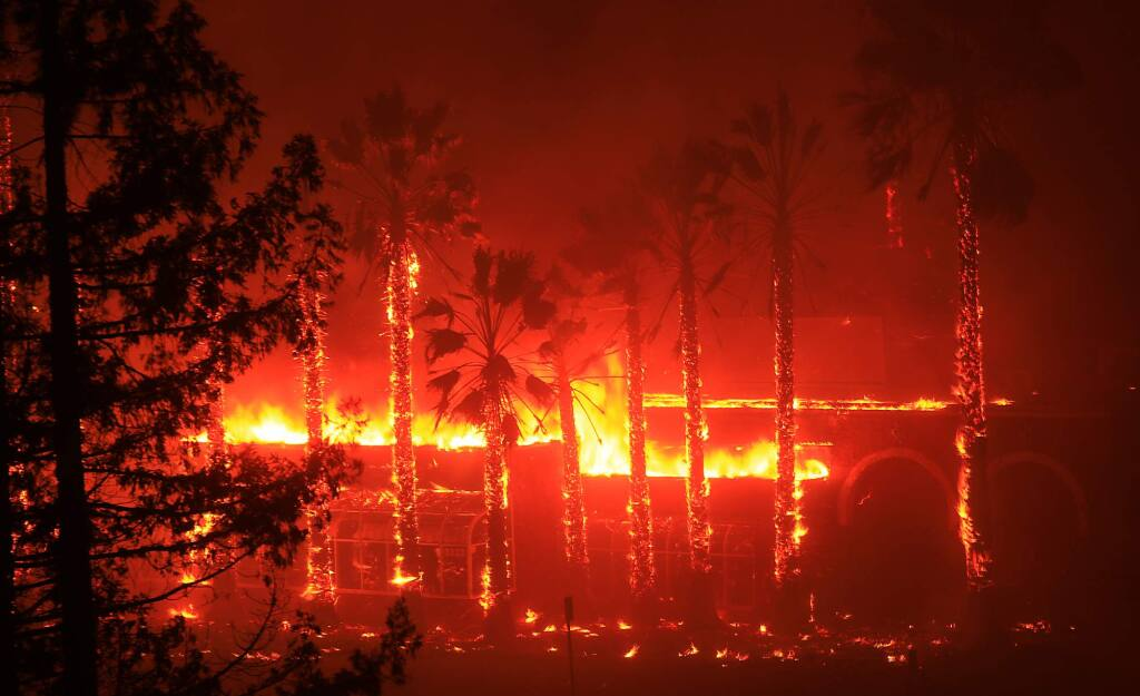 Along Cleveland Ave. in Santa Rosa, Puerta Vallarta Restaurant burns to the ground, Monday Oct. 9, 2017. (Kent Porter / Press Democrat) 2017