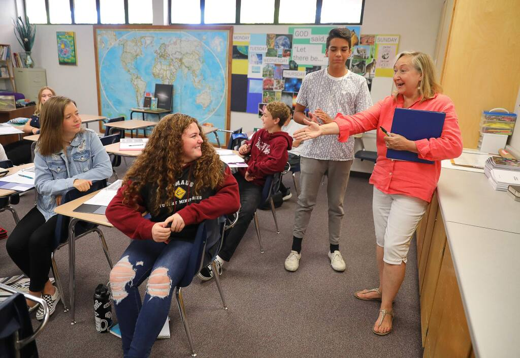 Nixie Laremore, right, discusses body language as a form of communication with students Jake Hammer and Katy Seidler during an english and science class at the new Victory Christian Academy, in Santa Rosa on Friday, September 6, 2019. (Christopher Chung/ The Press Democrat)