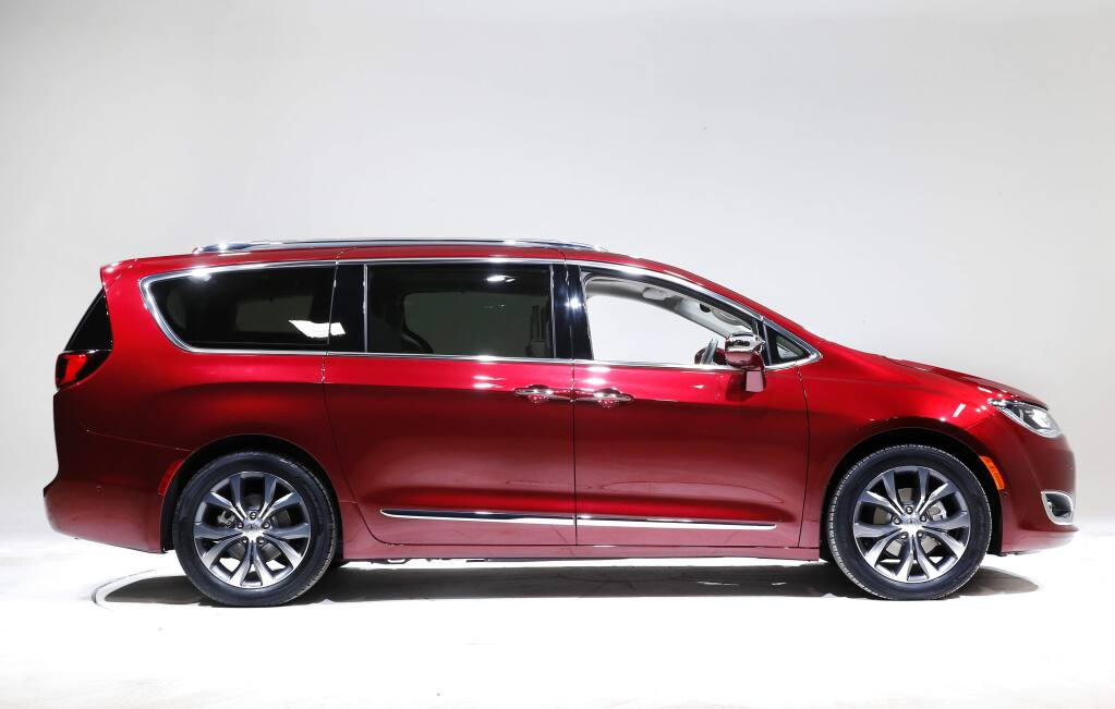 FILE - This Friday, Jan. 8, 2016, file photo, shows the 2017 Chrysler Pacifica, in Auburn Hills, Mich. Fiat Chrysler and Google announced Tuesday, May 3, 2016, that they will work together to more than double the size of Google's self-driving vehicle fleet by adding 100 Chrysler Pacifica minivans. (AP Photo/Paul Sancya, File)
